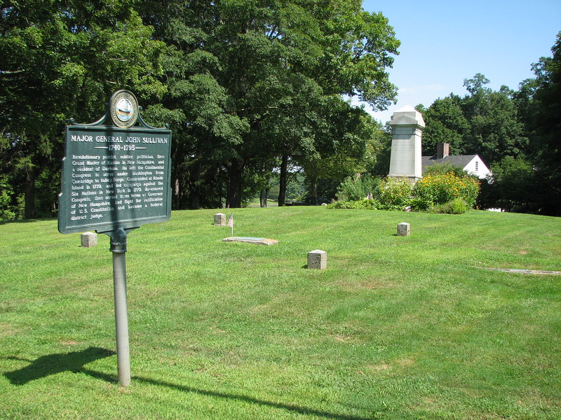 In front of the house is a town green, shown here with the historical marker, the granite monument, and the house in the background.