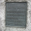 Closeup of the plaque in front of the house