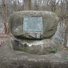 The boulder is located at the end of Old Fort Street, which is off Rt 4, south of Rt 197, in Fort Edward. The street dead-ends at the river.