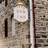 Sign on the corner of the inn.
