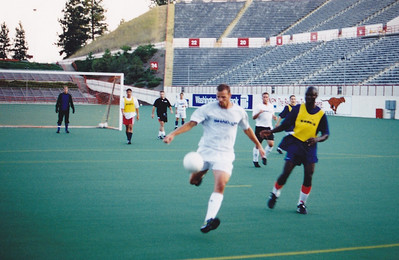 Defender Craig Waibel in the rare act of shooting - I probably wasn't safe where I was - as Simeon Enemuo looks on.
