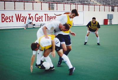 Too bad this is out of focus cuz it is a good shot of Mike Thompson (bottom), Craig Waibel (middle) and Bret Houck (standing) battling for the ball with Jeff McAllister looking on.