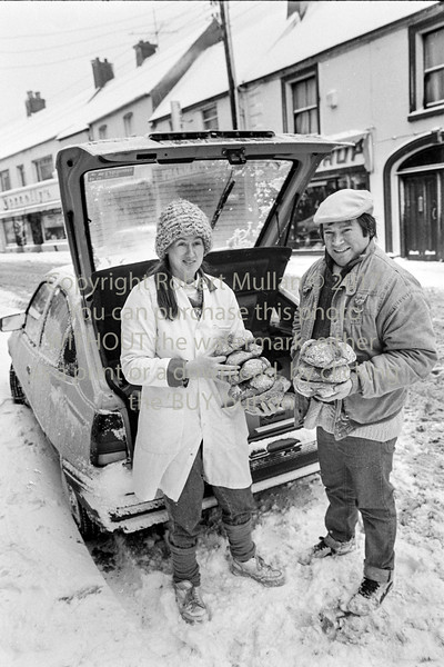 Michaela and Gerry Kennedy of 'The Dainty Bakery', Arklow delivering bread after a heavy snowfall.  Circa 1986