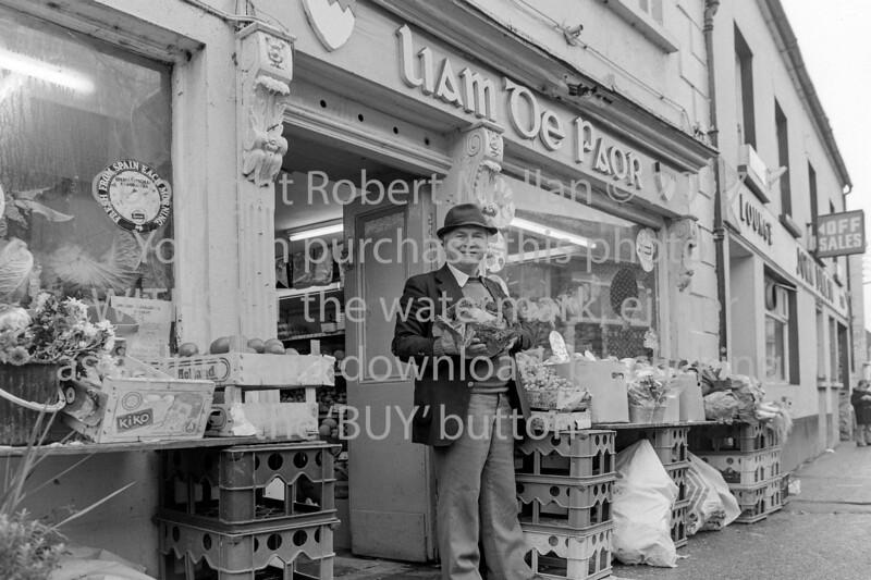 Arklow greengrocer Liam Power outside his Lr Main Street shop.  Circa 1980