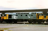 Complete with Eastfield Highland terrier, 26032 has ended her working life with withdrawal the following month from this photograph taken on 4 September alongside Inverness carriage depot. She met the cutter's torch in february 1995.