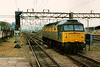47300 passes light through Bletchley on 29 April 1994. She was withdrawn in August 1995.