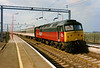 With a flush front end 47776 Respected takes a WCML Mark 3 rake through Wolverton on 7 April 1995.