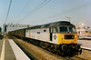 With embellished window surrounds, 47311 Warrington Yard heads south through Bletchley on 6 September 1991.