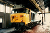 50008 Thunderer inside the maintenance shed at Old Oak Common on 25 May 1987. 50008 survives in preservation on the East Lancashire Railway.