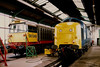 58049 Littleton Colliery shares depot space 55016 GORDON HIGHLANDER inside Shirebrook on 7 June 1987.