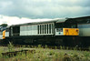 Without any coal markings, 58007 Drakelow Power Station is seen stabled at Didcot on 24 September 1995.