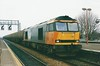 LoadHaul 60038, the former Bidean Nam Bian passes through Didcot on 20 February 1998 with the 6B33 1340 Theale - Robeston empty tanks.