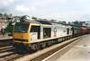 60056 William Beveridge works a steel train through Newport on 7 July 1999.