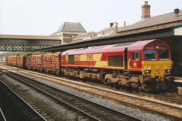 66137 works a loaded log train East through Newport on 28 June 2000.