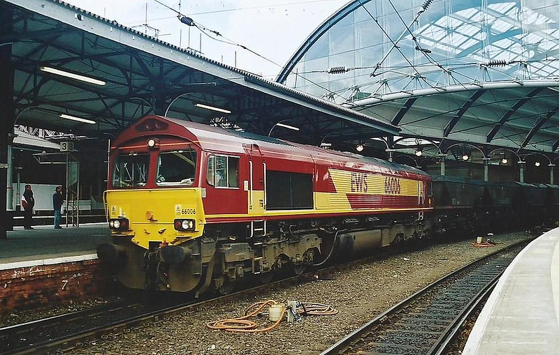 66006 passes though Newcastle Central on 28 March 2000 with a MGR working.