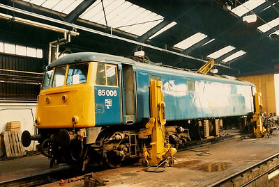 85006 is seen inside Bletchley depot on 25 April 1987 receiving attention to a burnt out traction motor. This is the only class 85 to be preserved, the other 39 all going for scrap.