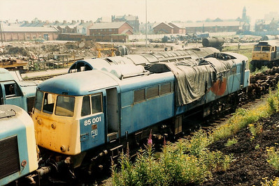 85001 stands withdrawn in Flag Lane sidings at Crewe Works open day on 4 July 1987. Withdrawal came about due to serious fire damage sustained in October 1985 at South Kenton. She was eventually scrapped at Glasgow in April 1989.