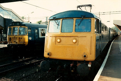 With 310093 in the background working the 1824 to Birmingham New Street, 85003 stands at Northampton awaiting departure time with the 1830 Northampton - Euston 'Network Express' on 15 August 1987.