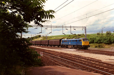 85009 takes an UID freight south through Milton Keynes on 8 July 1988. Was renumbered to 85102 in June the following year.