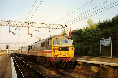 86415 Rotary International calls at Milton Keynes on 22 July 1989 with the 1903 Euston - Manchester Piccadilly. This service also called on this date at Wolverton and Northampton due to the choas caused by the previous days derailment at Harrow.