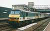 90023 hauls 92034 Kipling and 92012 Thomas Hardy north through Stafford on 5 March 1998. As of March 2015 the 90 was stored at Crewe whilst 92034 was working in Bulgaria and 92012 was at work in Romania.