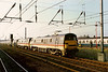 Blunt end leading, 91004 + 91005 head a test train of Mark 3 sleeper stock at Peterborough on 19 May 1989.