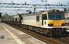 92011 Handel passes through Stafford on MGR wagons on 4 May 2000.