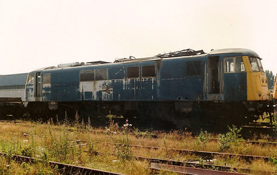 A weather beaten 82005 passes time at the 'Crewe graveyard' namely the Electric Depot on 22 July 1989. She was scrapped during the summer of 1993 at Rotherham.