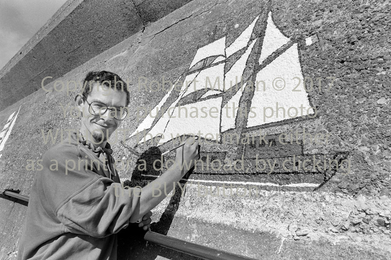 Pat Davis with one of his murals - date unknown