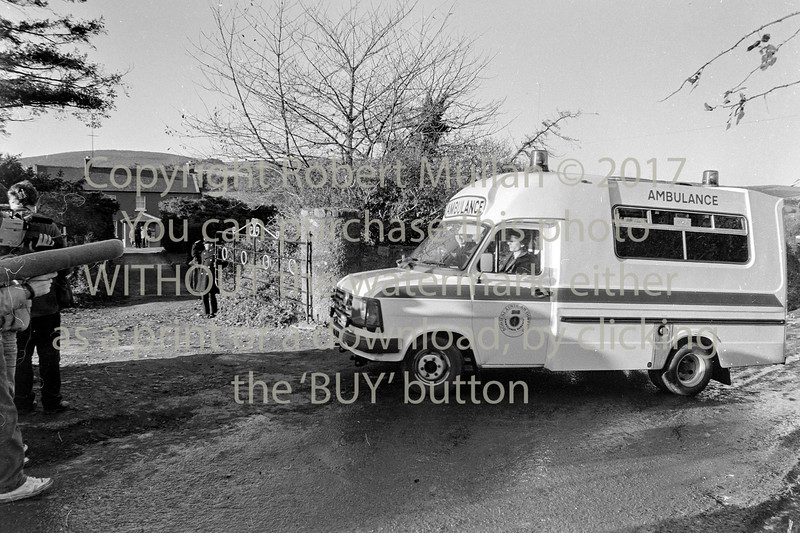 An ambulance arrives at the home of Margaret Nolan in Kilbride who along with her daughter Anne was found murdered there 1n 1986.   Date 1986