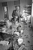 Det Garda Joe Comiskey examines a crime scene at Rathdrum.  Circa 1980s