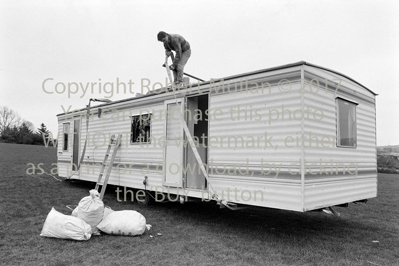 Preparing to move a mobile home with the aid of a helicopter near Ashford - 1980s/90s