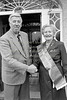 Jim Giff, one of the organisers of the Wicklow St Patrick's Day Parade, presents the Grand Marshal's Sash to Maureen Gelletilie - 1980s/90s