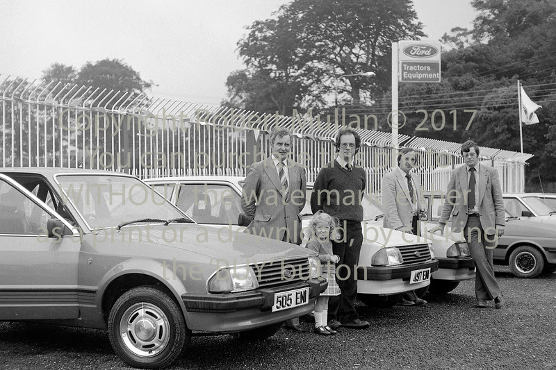 Customers of the Abbey Service Garage, Wicklow taking delivery of their new Ford Escorts.  Date 1980