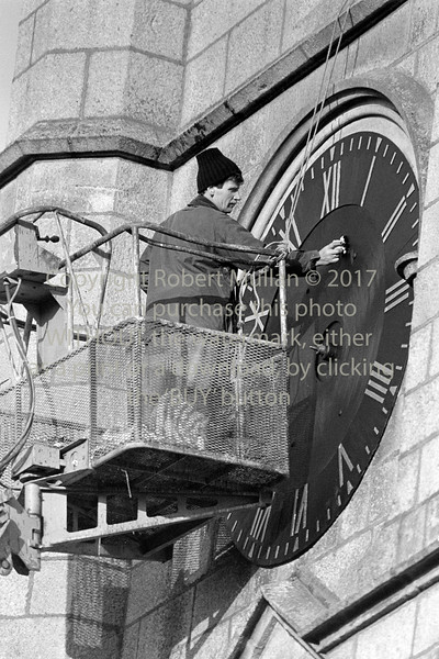 Cleaning the face of the Church clock - 1980s/90s