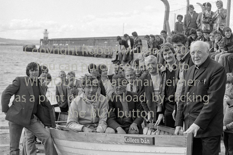 The launch of 'Colleen Ban' with members of Wicklow Rowing Club and Canon Crinion.  Circa 1979