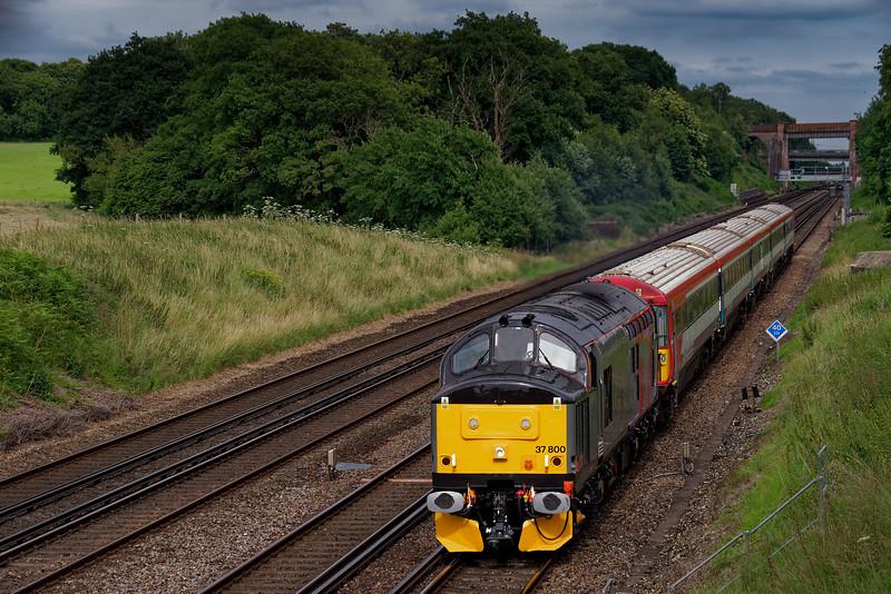 37800 hauling 442423 as 5Q42, the 12:08 Three Bridges Tilgate Sidings - Eastleigh Arlington. Shown passing Totters Lane, Potbridge, on 7th July 2016.