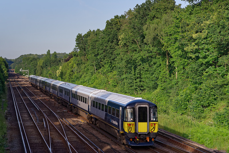 442403 and 442408 approaching Farnborough with 9B95, the 18:48 Waterloo - Poole. <br /> 28th June 2019.