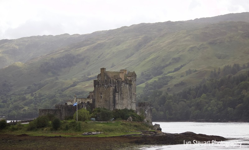 Drive by shot of Eilean Donan Castle on the way to Isle of Skye