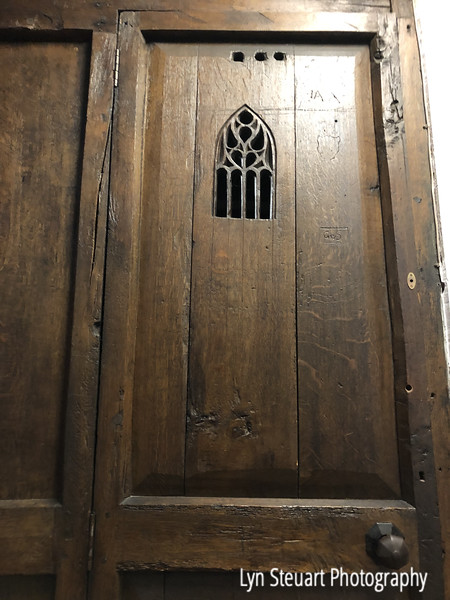 Wooden door of confessional dating back to Middle Ages at King's College Chapel