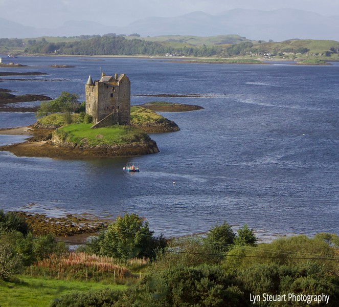 drive by shot of Castle Stalker, Appin, on the way to Fort William
