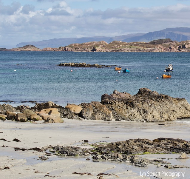 boats in Finnophort Bay on the shore of Isle of Iona