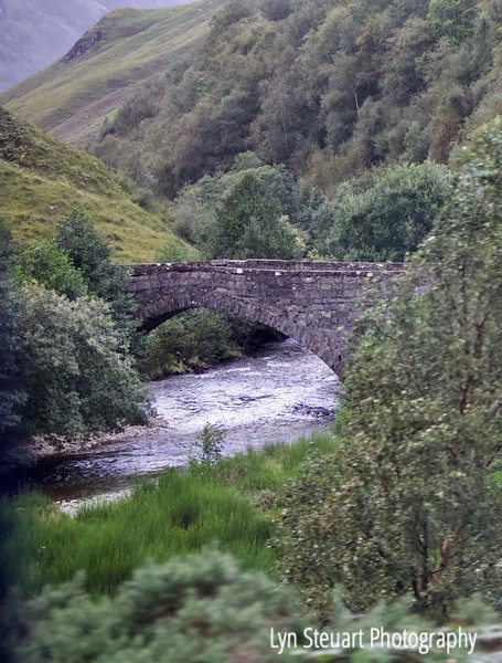 Drive by shot of Stone bridge on the way to Portree on Isle of Skye