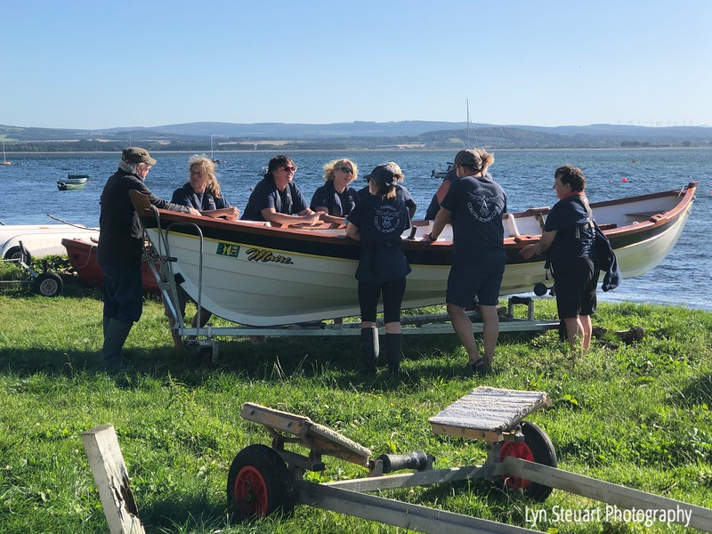 The women rowers of the Findhorn Coastal Rowing Club having just finished rowing through rough waters in the Moray Firth