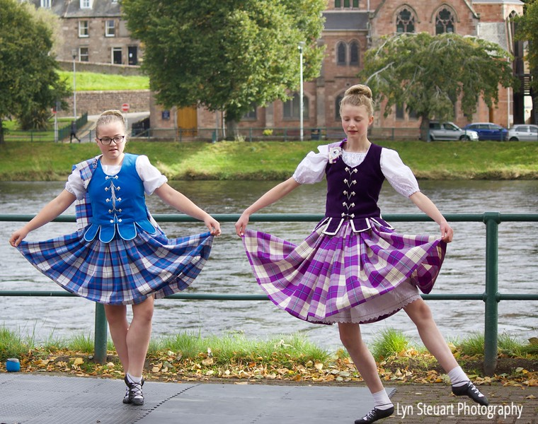 Highland dancers beside the river Ness in Inverness