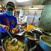 "Syla Sengaloun, son of the owners of Anon's Thai Cuisine, in Brattleboro, Vt., cooks food in a busy kitchen during their first time opening on Friday, May 1, 2020, since they closed from the COVID-19 pandemic on March 14. ""So far everything is running smoothly,"" said Sengaloun. ""Business is going great, we missed our customer and our customers missed us."""