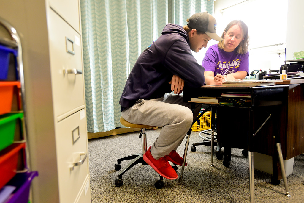 . Josh Volf works with teacher Allyson Damick during class at Crossroads School in Longmont, Colorado on Nov. 10, 2017. Volf was adopted at age 11 from Ukraine. At 19, Volf has now returned to school and is planning to graduate in May. (Photo by Matthew Jonas/Times-Call)