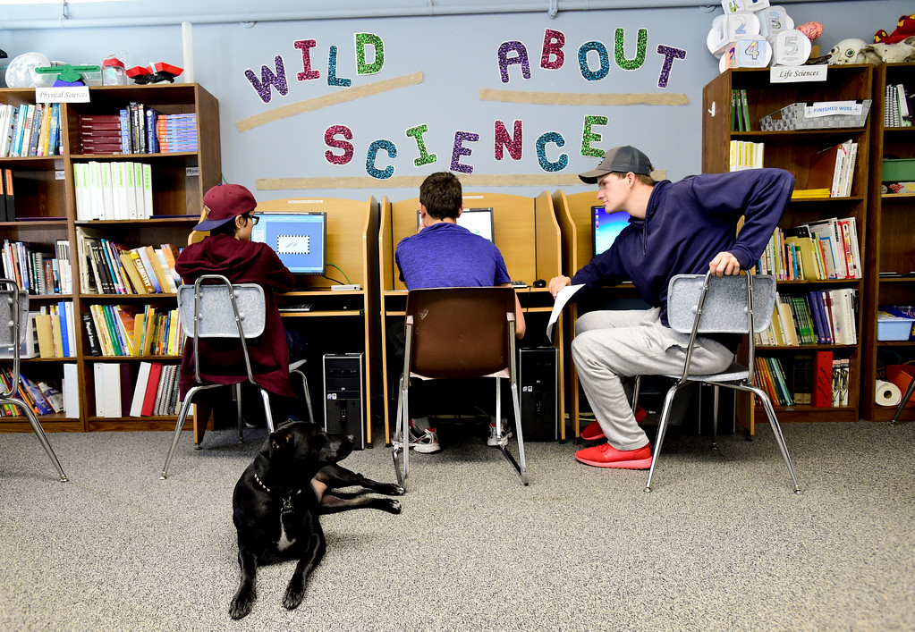 . Josh Volf, right, waits for the internet to come back on after an outage during class at Crossroads School in Longmont, Colorado on Nov. 10, 2017. Volf was adopted at age 11 from Ukraine. At 19, Volf has now returned to school and is planning to graduate in May. (Photo by Matthew Jonas/Times-Call)