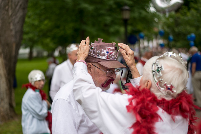 Waner Holman '56 is fitted for his tiara before processing.<br /> <br /> Reunion participants march with their respective class years in the annual Reunion Parade on Saturday June 11 2016.