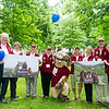 """The Katahdin 8,"" a group of friends from the class of 1966 that have stayed in touch, pose for a photo with the Bobcat before processing. They recently hiked Katahdin together.<br /> <br /> Reunion participants march with their respective class years in the annual Reunion Parade on Saturday June 11 2016."